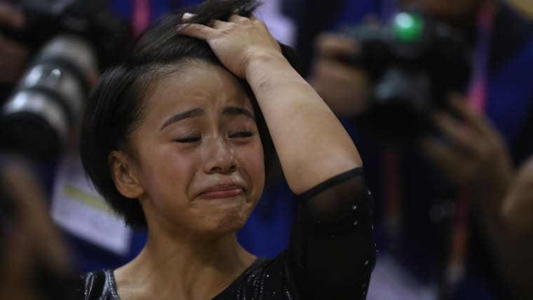Mai Murakami reacts after her floor routine in the all-around final in Doha