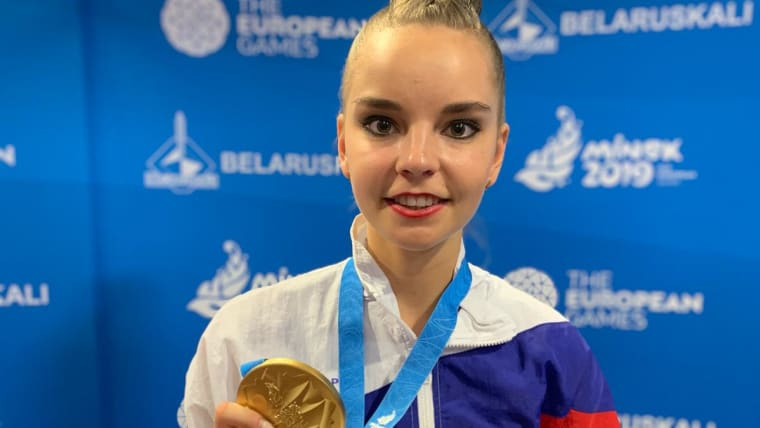 Dina Averina shows off a gold medal at the 2019 European Games. Photo: Olympic Channel