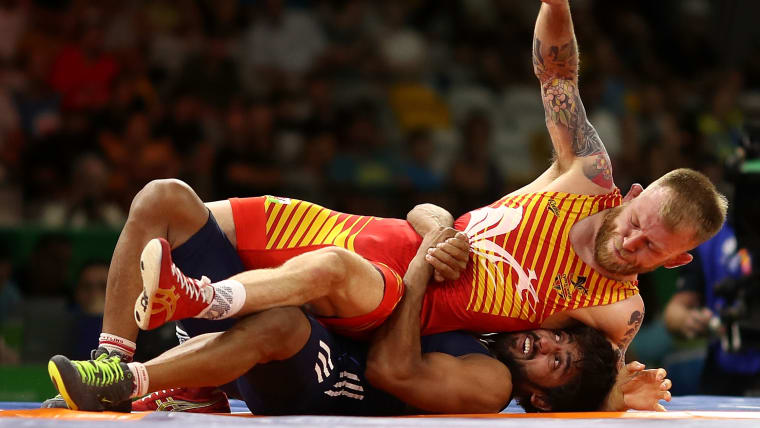Bajrang Punia on his way to victory over Wales' Kane Charig in the 2018 Commonwealth Games freestyle 65kg final