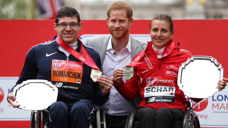 Daniel Romanchuk and Manuela Schaer pose for photos with the Duke of Sussex after winning the 2019 London Marathon
