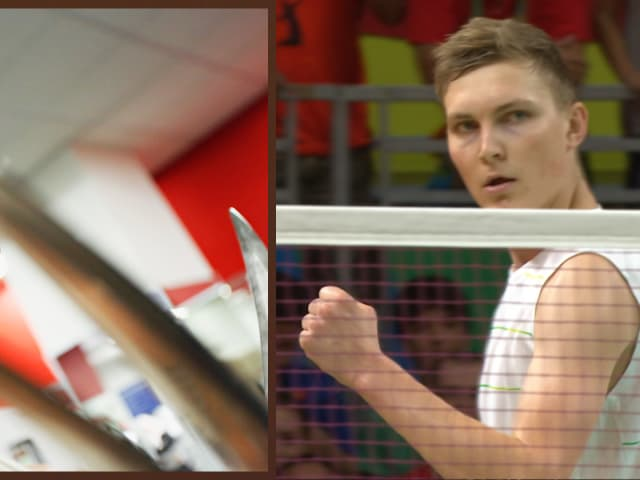 World champion badminton player Viktor Axelsen offers Hugh Jackman a game