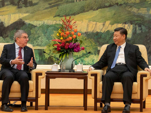 IOC President Bach and Chinese leader Xi hail