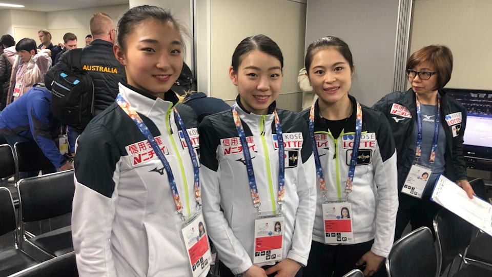 (Left to right) Kaori Sakamoto, Rika Kihira, and Satoko Miyahara pose after the draw for the ladies' short program.