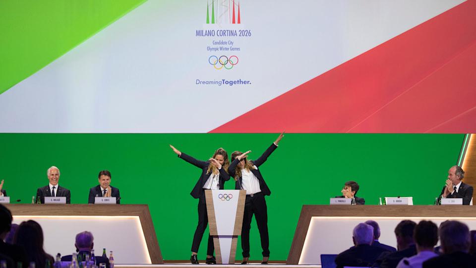 Olympic champions Michela Moioli and Sofia Goggia on stage during the Milan–Cortina 2026 final presentation. (Greg Martin/IOC)