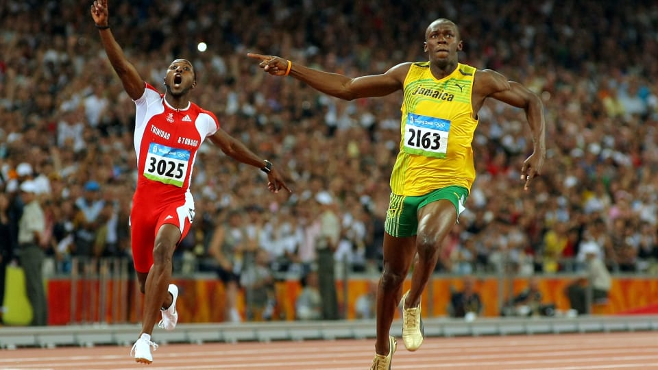 Richard Thompson and Usain Bolt celebrate as they cross the line in the 100m Final at Beijing 2008