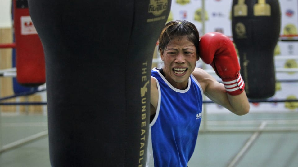 Mary Kom training with a punchbag in Pune in March 2012