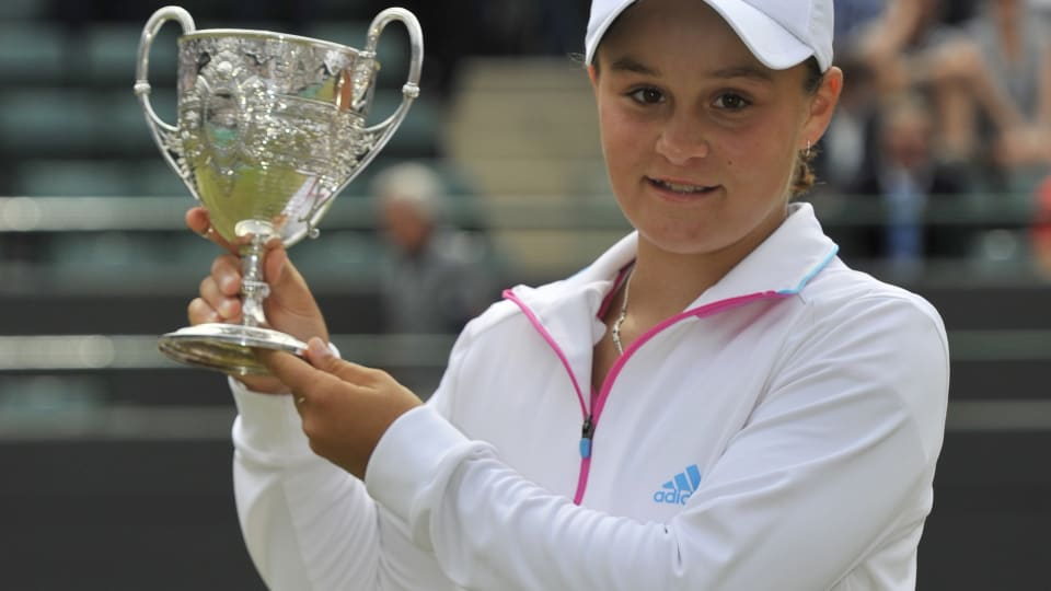 Ashleigh Barty holds her trophy for winning the 2011 Wimbledon Girls' Singles title