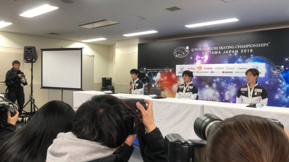Team Japan faces the media after practice