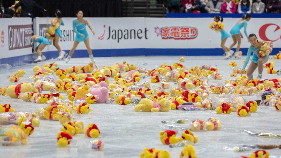 Winnie the Pooh soft toys on the ice after Yuzuru Hanyu's free skate