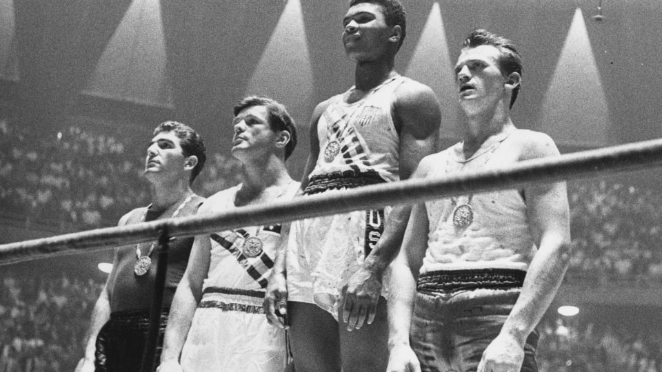 Muhammad Ali, known then as Cassius Clay, after winning light heavyweight gold at the 1960 Rome Olympics