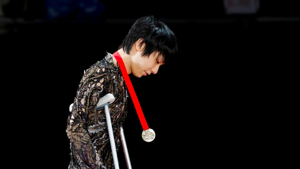 Yuzuru Hanyu of Japan on crutches during the Rostelecom Cup medal ceremony