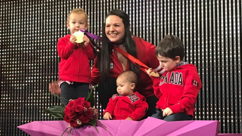 Canadian weightlifter Christine Girard receives her re-allocated Olympic medals with her three children.