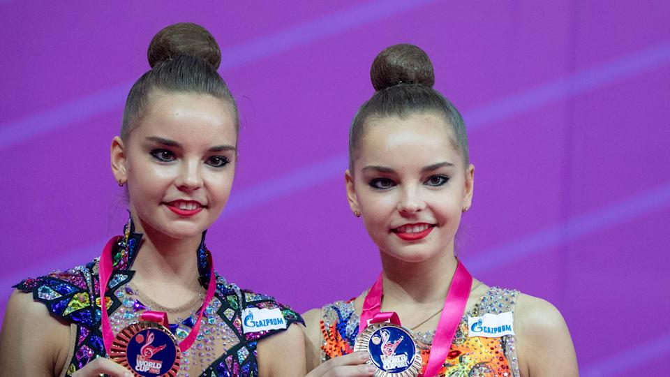 Dina and Arina Averina pose after a FIG Rhythmic Gymnastics World Cup event.