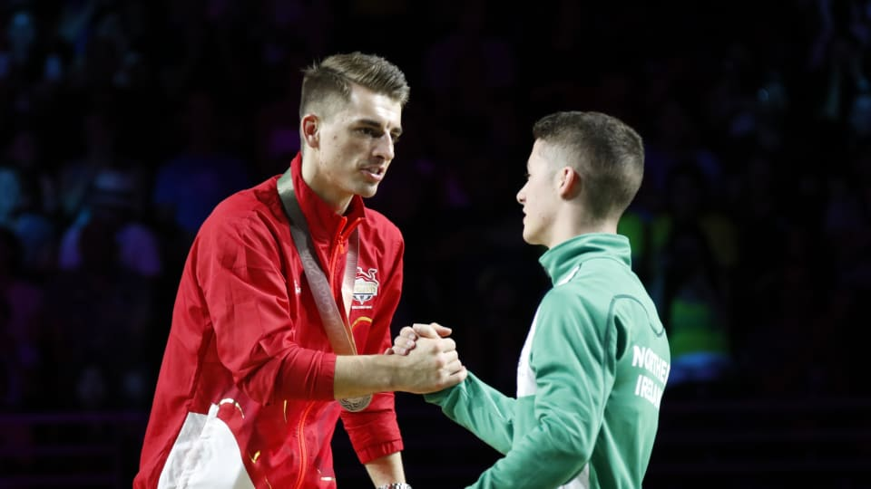 Pommel horse runner-up Max Whitlock (L) congratulates winner Rhys McClenaghan at the 2018 Gold Coast Commonwealth Games